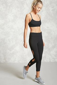 A pair of knit athletic leggings featuring a hidden key pocket, seam-stitched panels, and cutout sides.