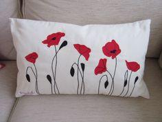 Cushion with appliquéd poppies.