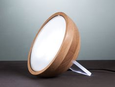 Hemispere Mirror Light by Olga Bielawska