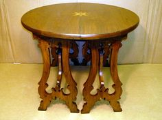Artisan Furniture & Cabinetry        Goya  Entry Table / Demilunes in walnut