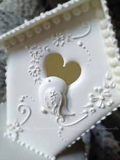 Lovely piping, royal icing bird house and bird; beautiful design for a decorated bird house cookie