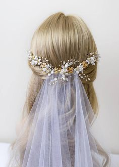 ODELIA - Bridal headpiece in gold has exquisite detailing with playful flower, glamorous rhinestones, gorgeous filigrees and beautiful crystals and pearls. The Odelia bridal headpiece has and alluring cascading shape which makes it so versatile to be able Veil Hairstyles, Wedding Hairstyles, Bridal Hairstyle, Wedding Hair Inspiration, Wedding Hair And Makeup, Hair Wedding, Boho Wedding, Flower Headpiece, Bridal Hair Vine