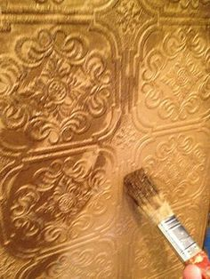 how to paint paintable wallpaper. give it a base coat color, followed by lightly brushing over with a second metallic color for detail work. Can add a third lighter colored metallic if desired.