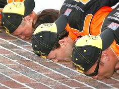 Stewart, an Indiana native, kisses the bricks after winning the 14th running of the Allstate 400 at the Indianapolis Motor Speedway in July of 2007.