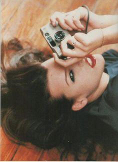 Milla Jovovich with a Contax T2.