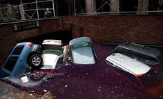 Cars floating in a flooded subterranian basement following Hurricaine Sandy on Tuesday in the Financial District of New York.