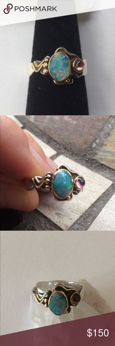 Artisan Opal and Ruby Ring Love this Ring! But sadly I don't have enough fingers! Very Beautiful flash Boulder Opal and Genuine Ruby Set in 14k Gold with Sterling Silver band.💖 This is an Artisan made piece and not stamped has been tested by my Jeweler is 14k and Sterling. Beautiful 🌟 Unique Antiqued Artist made. Good used condition, band has some scratches that can easily be buffed by Jeweler ⭐️ Size 9 1/2 Jewelry Rings