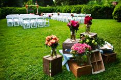 ceremony decor - assorted fruit crates decorated with orange, dark pink, and red bouquets - photo by Washington DC based wedding photographers Holland Photo Arts
