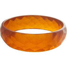Flashing with faceted color, this chunky Bakelite bangle is a rich, deep honey color.  It has wall that are 3/4 inch tall and is the standard 2-1/2