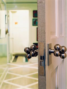 Celerie Kemble Bedrooms | Celerie Kemble Photo - Bauble knobs on a white door edged with grass ...