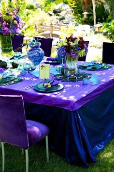 For the outdoor peacock wedding. Lots of purples, teals and blues, featuring arrangements with vivid hues.