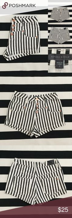 """[Kendall&Kylie] high-rise striped jean shorts sz7 [Kendall&Kylie] high-rise/waisted striped jean shorts sz7 •listing •good used condition •size 7, may fit 26-27 •high-rise shorts with gold button fly, 4 pockets •black and white stripes •length/inseam 1.5"""" (short) •material 98% cotton 2% spandex, feel like stretchy jean material •tear in back band of fabric, does not affect fit •offers welcomed using the offer feature or bundle for the best discount• Kendall & Kylie Shorts Jean Shorts"""