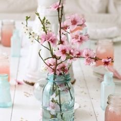 Using glass jars, bottles, and vases can be a simple and inexpensive way to decorate your home. Have a look at the beautiful gallery. #dwellinggawker