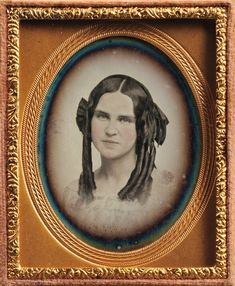 Ninth-plate Vignetted Daguerreotype of a Young Woman with long ringlets