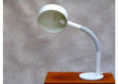 White Desk Lamp by Hala Zeist   Description Large desk lamp by Hala Zeist, a manufacturer from the Netherlands. This lamp is completely white. The arm of the lamp is movable and flexible. 125E