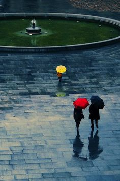 Colourful umbrellas on a dark and stormy day