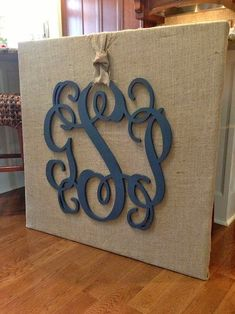 monogram on burlap covered canvas wall art by adela