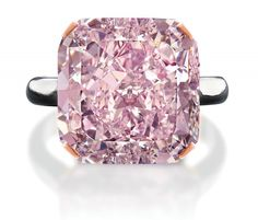 10-Carat Light Purplish Pink Diamond, This 10-carat gem was cut and polished from a rough 21.35-carat stone mined in South Africa, which makes it one of the world's largest pink diamonds ever excavated. It took 3½ months to cut and polish the stone. It's set in a platinum ring.