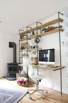Industrial style shelf and desk space.  I like this idea, especially if the pipes could mount on  the wall instead of the floor