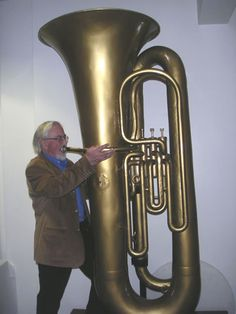 The Giant Tuba, was made in the early century by Besson, London. The Giant Tuba has over 34 feet of tubing, weighs 112 pounds, and is nearly 8 feet tall. Brass Musical Instruments, Brass Instrument, Sousaphone, Music Machine, Learn To Play Guitar, Brass Band, Trombone, Sound Of Music, Playing Guitar