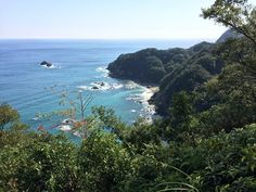 "Pacific Ocean view from the ""Shikoku no michi"" near the town of Hiwasa. The scene has a tropical feel to it! The ""Shikoku no michi"" is a hiking/walking route that encircles the island of Shikoku and sometimes overlaps the route of the Shikoku 88 Temple Pilgrimage.The ""Shikoku no michi"" highlights the natural and cultural treasures of the island and portions of it can be used as an alternate routing for those on the Shikoku Pilgrimage."