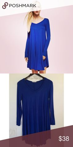 Royal Blue V Neck Longsleeve Trapeze Boho Dress Stunning Fall Royal Blue or Magenta V Neck Longsleeve Flared Tunic Trapeze Boho Dress. Material: 95% Rayon 5% Spandex. Made in the USA. No Trades. Price is firm unless bundled. 10% off 2 or more items or 15% 3 or more items. GlamVault Dresses