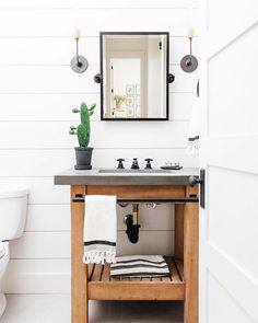 This bathroom from @lexigracedesign has everyone in the office lusting after our Abbott Single Sink Console. We love how the concrete top and rustic wood stands out against the #brightwhite #shiplap . #brightwhitewednesday #bathroomdesign #bathrooms