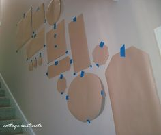 make templates of your frames and hang to see if you like it first before putting lots of holes in your wall.