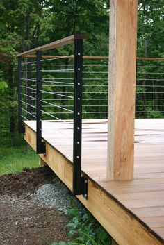Deck Railing, steel posts and cable, wood top                                                                                                                                                                                 More