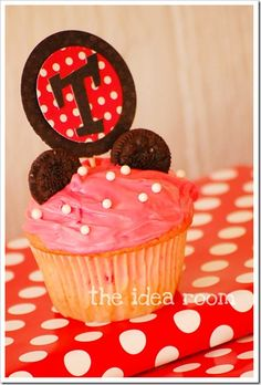 Another Mickey (or Minnie) cupcake idea.  Maybe bold red frosting with two white dots to represent Mickey?