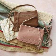 Elan Crossbody Bag - dreamy, pebbled leather with stitched accents, tasseled zipper pull and adjustable shoulder strap.