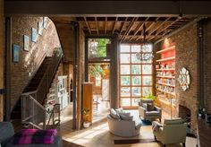 London home with a garage door–style sliding glass door to retract when the weather is nice