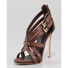"Giuseppe Zanotti ""Zip-Back High-Vamp Crisscross Sandal"". The height is just so unreal"