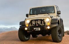 The AEV Premium Front Bumper is the industry's only stamped steel bumper, providing the absolute ultimate in looks, protection and functionality. Jeep Tj, Jeep Wrangler Rubicon, American Expedition Vehicles, Jeep Brand, Jeepers Creepers, Offroad, 4x4, Monster Trucks, Jeep Stuff