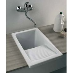 Add a small ceramic wash basin with a built in wash board to your laundry room for minimal use of space and optimal efficiency when it comes to dirty laundry!  Make your dream home a reality with CustomHomesbyJScull.com