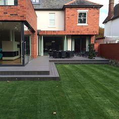 Graphite grey composite decking in Formby, Liverpool. Back Garden Design, Backyard Garden Design, Garden Landscape Design, Patio Deck Designs, Patio Design, Contemporary Garden Design, House Extension Design, Farmhouse Landscaping, Outside Patio