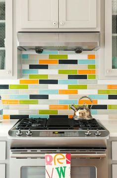 traditional kitchen by Bret Franks Construction, Inc. *love the multi-colored backsplash*