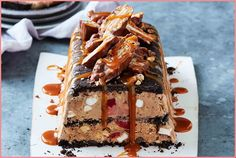 Oreos, picnic bars and peanut butter - oh my! This no-cook rocky road dessert has it all. No Cook Desserts, Frozen Desserts, Just Desserts, Dessert Recipes, Frozen Treats, Christmas Recipes, Dessert Ideas, Cake Recipes, Xmas Food