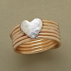 """CROSS MY HEART RING--A sterling silver heart kisses the front of our ring. In back, the continuous coil of 14kt goldfill crosses over itself. A handcrafted exclusive in whole sizes 5 to 9. 3/8""""W."""