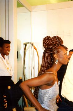 Khamit Kinks styled Iman's hair for Essence Magazine 1994.  Beauty Editor Mikki Garth Taylor in the background.