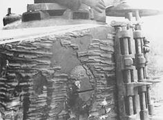 The detail on a Tiger 1 turret showing patches of worn off zimmerit and mounted track link.