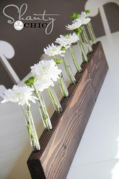 what a great idea to use an old wooden board to make this unique flower vase- I love this!!