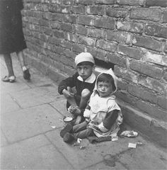Jewish children beg for food in the streets of the Warsaw ghetto.