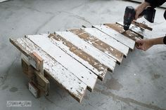 attaching angled boards for a reclaimed wood Christmas tree / funkyjunkinteriors.net