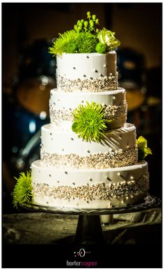 4 tiered white wedding cake with green flowers.  borterwagner photography  http://www.borterwagner.com/