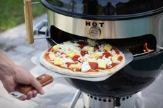 Imagine authentic wood-fired pizza from your kettle grill. The KettlePizza® insert will turn your grill into a real pizza oven! Works with all kettle grills including Weber®, Stok® and others. I would get a weber just to make wood fired pizza Pizza Oven Kits, Pizza Ovens, Fancy Pizza, Instant Pot, Fire Pizza, Grill Accessories, Wood Fired Pizza, Food And Drink, Favorite Recipes
