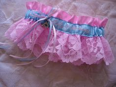 Pink personalized satin and lace wedding garter with rhinestone initial charm.  TheWeddingGarter.com