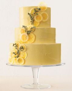 Wedding Cake Recipes Lemon-Thyme Pound Cake with Meringue Buttercream - Martha Stewart Weddings [channel] - This provencial masterpiece created by Wendy Kromer alternates layers of lemon curd and vanilla buttercream. Amazing Wedding Cakes, Unique Wedding Cakes, Amazing Cakes, Unique Cakes, Candied Lemon Slices, Candied Lemons, Fruit Wedding Cake, Wedding Cake Flavors, Lemon Wedding Cakes