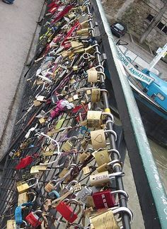 A bridge in Paris where people in love write their names on a lock, lock it to the fence, and throw the key into the Seine. Then even if the relationship ends, there is always that permanent reminder of the love that you once shared.