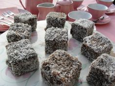 Ever since my daughter recently reminded me that I often bought lamingtons for the house when they were younger, I have been craving lamingtons. Apparently lamingtons originated in Australia and . Cake Mix Recipes, Baking Recipes, Baking Ideas, Lamingtons Recipe, Dot Foods, Coconut Icing, Winter Dishes, South African Recipes, Winter Food